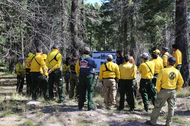 A fire ecology crew member discusses the factors that can contribute to fire severity