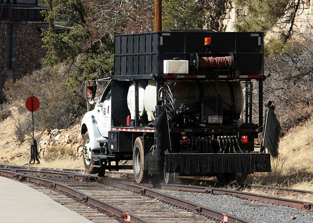 Applying herbicide along railroad tracks within Grand Canyon National Park
