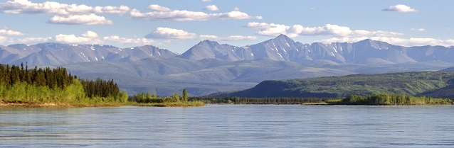 Yukon River with mountains in the background