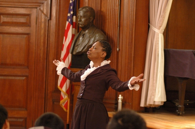 Kathy Hudson performs as Harriet Tubman for students