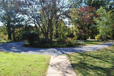 The round driveway at the Clara Barton House surrounds an island of trees and shrubs.
