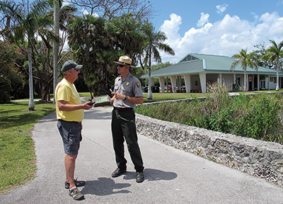 A park ranger talks with a park visitor along the Anhinga Trail (Credit: NPS Photo)