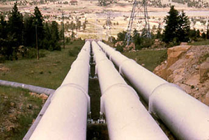 Image of three long and wide pipes extending a few hundred feet