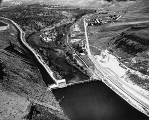 Black and white photo of Bosie Diversion Dam splitting the Boise River in two