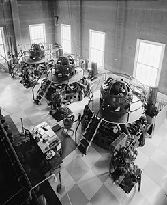 Black and white photo of engineers working inside the power plant