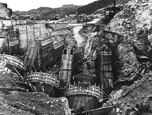 A black and white photo of Bartlett Dam being built