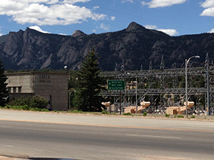 Photo of Estes Powerplant surrounded by mountains and blue sky