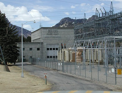 Photo of Estes Powerplant next to a large grid of power-lines