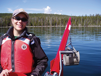 Research on Yellowstone Lake with Ponar sampler and winch attached to a boat