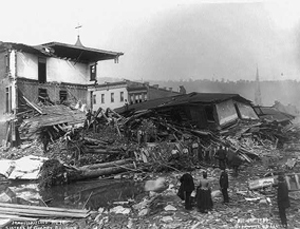 Black and white photo of a building demolished by flood water