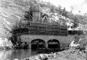Black and white photo of Guernsey Dam under construction