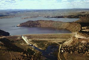 Sky view of Glendo Dam surrounded by large craters and water