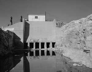 Black and white photo of Avalon Dam on the Pecos river.