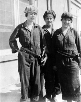Black and white photo of three women wearing labor suites