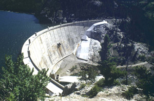 Photo of Gibson Dam's large crest shape with water in the background