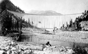 Black and white photo of Gibson Dam surrounded by trees