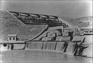 Black and white photo of Lahontan Dam's spillway over flowing with water