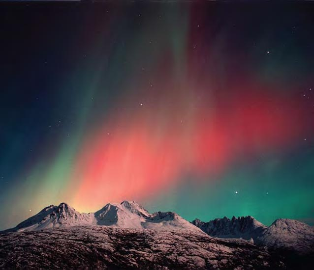 Red aurora over the Sawtooth Mountains.