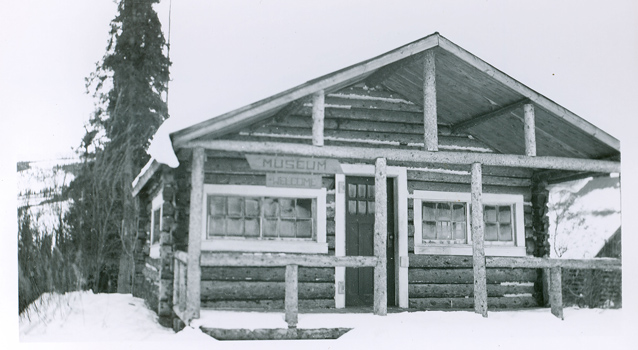 black and white photo of a log cabin museum in 1943