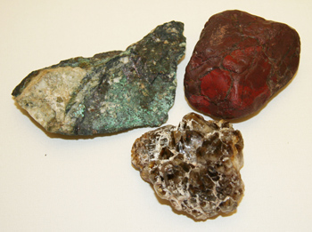 three rock and mineral samples