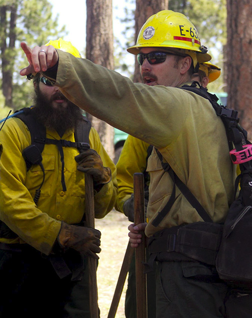 Wildland firefighters arrive on scene of a simulated wildfire