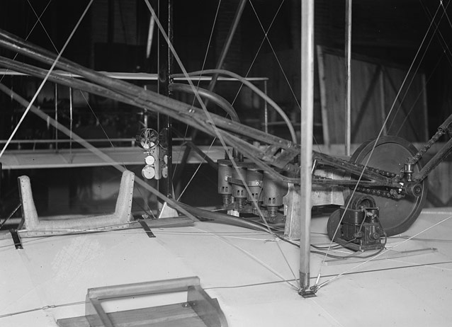 Restored Wright Flyer cockpit, showing hip cradle, instruments, and engine- 1928