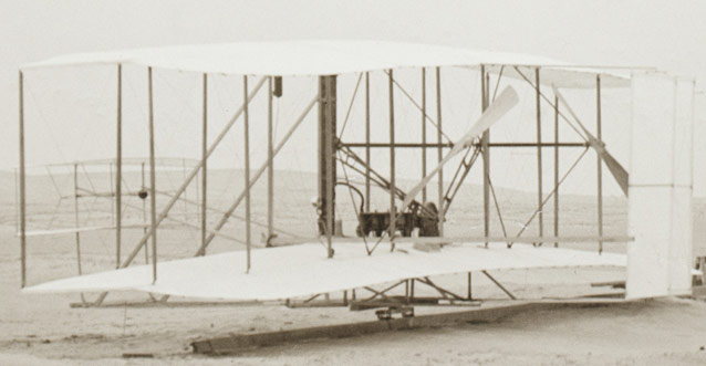 Wright Flyer showing elevator, engine, propellers, and rudder (L to R)- Kitty Hawk, 1903