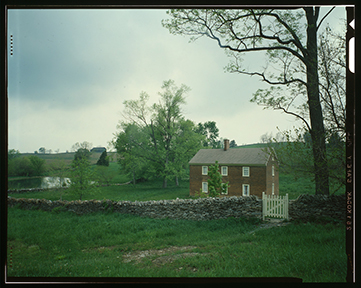 Shakertown village in Mercer County, Kentucky. A House with sky and grass in background