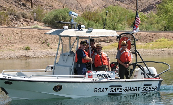 Law enforcement on patrol in a boat