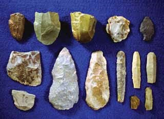 stone tool artifacts displayed on a blue background