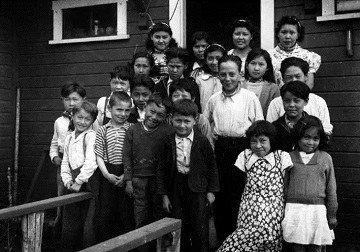 black and white photograph of 21 school children