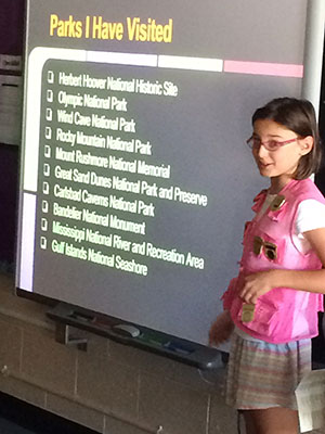 Talia, in her famous pink Jr Ranger vest, shares her experiences to her classmates