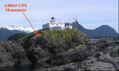 lighthouse atop a cliff, GPS unit labeled on side of hill
