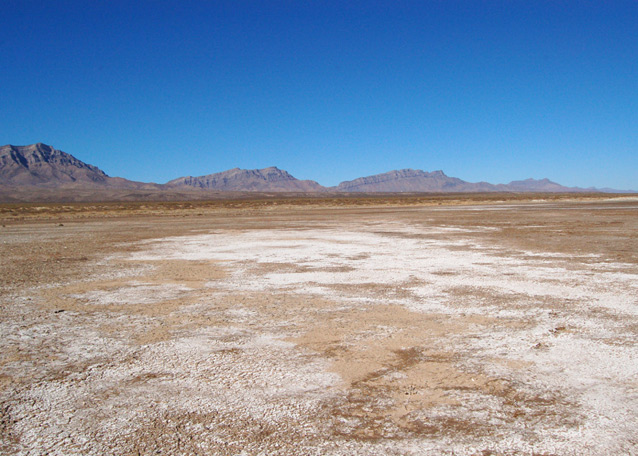 Patches of halite on the bottom of a dry Lake Lucero