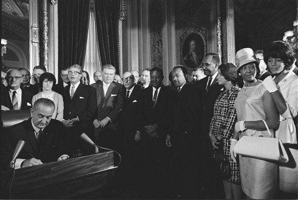 President Lyndon B. Johnson signs the Voting Rights Act