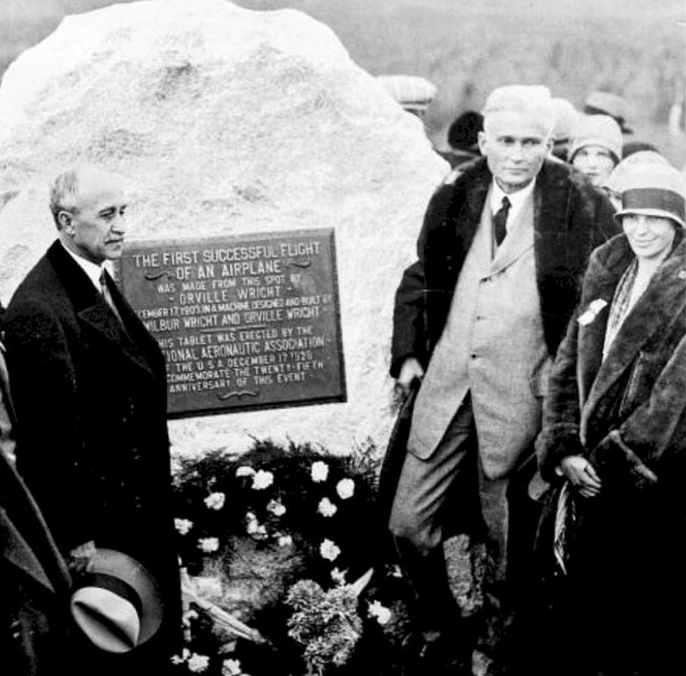 L to R- Orville Wright, Hiram Bingham, Amelia Earhart in front of boulder, 1928
