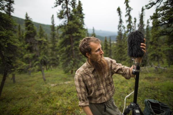 Betchkal installs sound-monitoring equipment near Triple Lakes in the Denali Park wilderness.