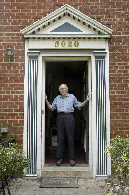 Dr. Franklin E. Kameny standing with his hands on both sides of his door frame
