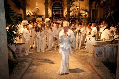 Party-goers dressed in white attend the annual White Party Week at the Vizcaya Villa