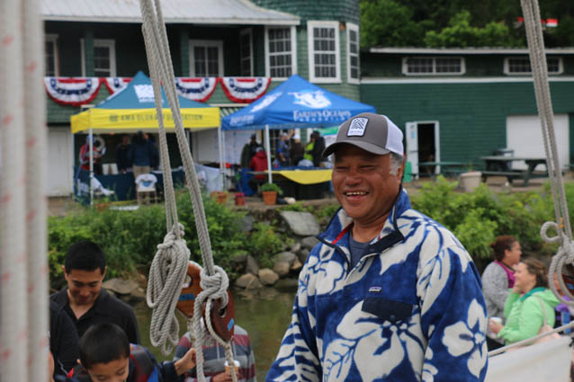 Captain Kalepa Baybayan smiles and greets guests aboard the Hōkūleʻa.