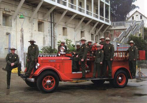 fully restored Diamond T with park employees in uniform