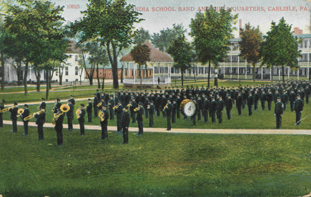 Student marching band playing on a field
