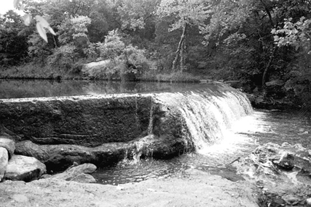 Water cascades over a low concrete dam at Panther Falls, circa 1999