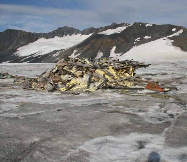 Remains of warming hut melting out of the Harding Icefield in September 2009