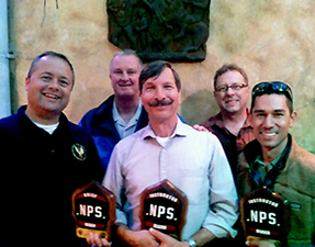 Fire Employees with plaques and awards for leadership