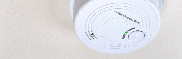 white carbon monoxide alarm on the ceiling
