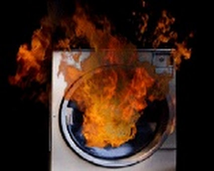 Dryer with fire coming out of it