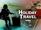 traffic with holiday travel text over the image
