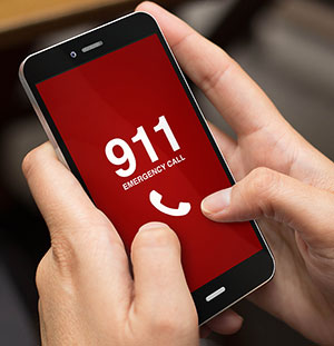 hand on a mobile phone calling 911