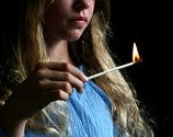 teenager girl with a long lit match